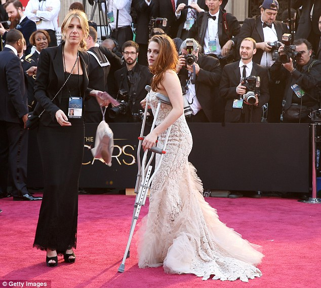 Oops-a-daisy: The 22-year-old star hobbled up the red carpet on crutches after cutting the ball of her foot on a piece of glass two days ago