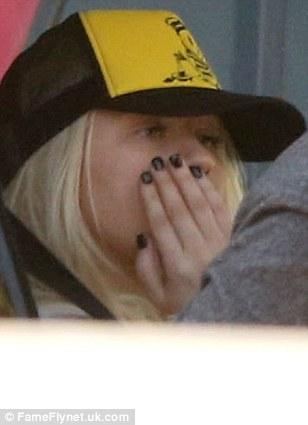Like a waiter: The blonde gave her boyfriend Matthew Rutler a rundown of her order through the passenger side window