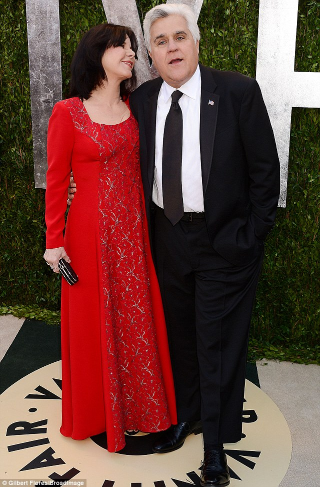 Suit and tie: He and Mavis Leno looked smart as they posed prior to the bash