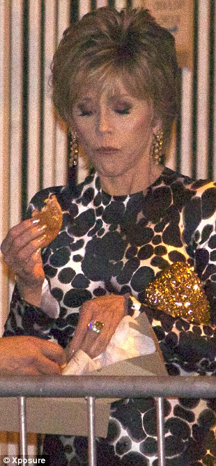 Hungry: The 75-year-old didn't care who watched her eat the sloppy food
