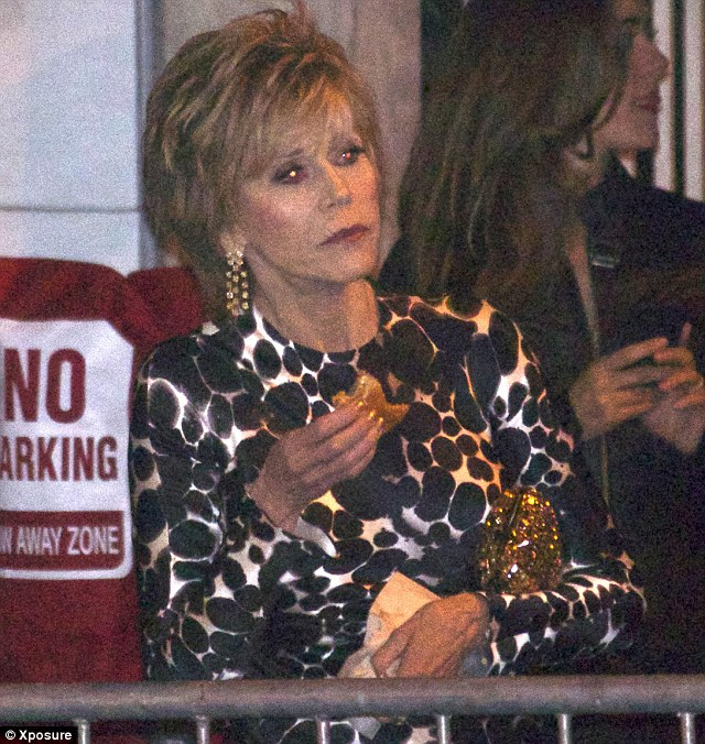 Juggling act: Jane clutched to her 'Claire' bag as she held her food in her hands
