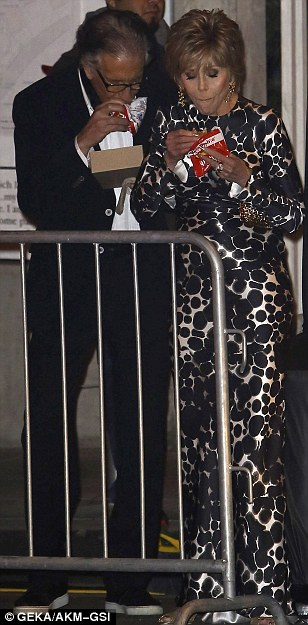 Glamour meets down-to-earth: The couple stood behind railing in their formal attire