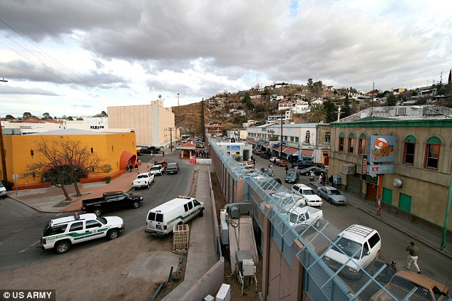 The Mexican/American border - Arizona is on the left and Nogales is on the right