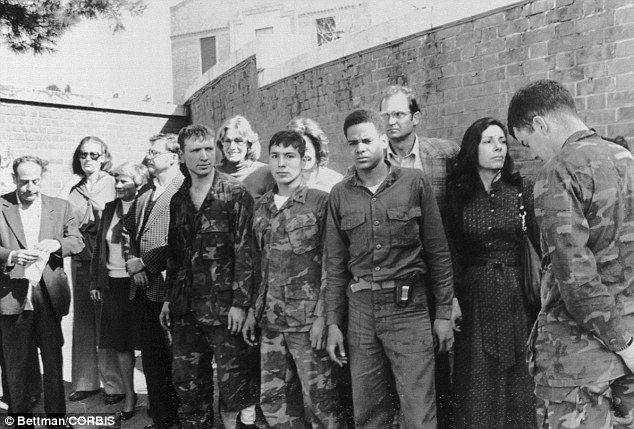 The American hostages being paraded outside the U.S. Embassy in Tehran in 1979