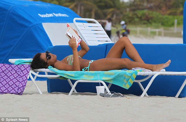 Light reading: Karina showed off her fantastic figure as she caught up on some light reading