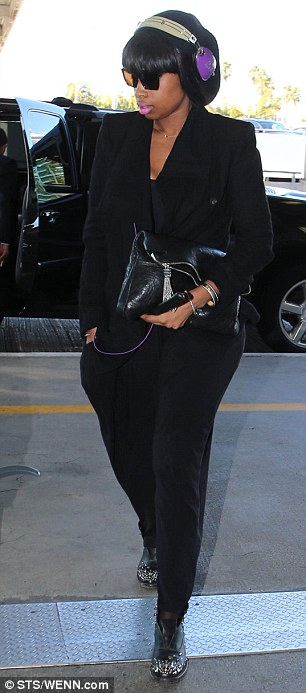 Cool customer: Jennifer donned an all black outfit of tapered pants and a cropped jacket
