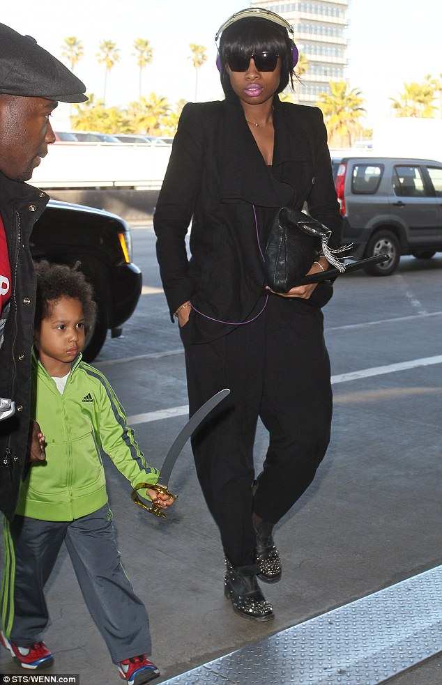 I'll protect you: Jennifer Hudson arrived at Los Angeles airport with her son David Daniel Otunga Jr on Monday