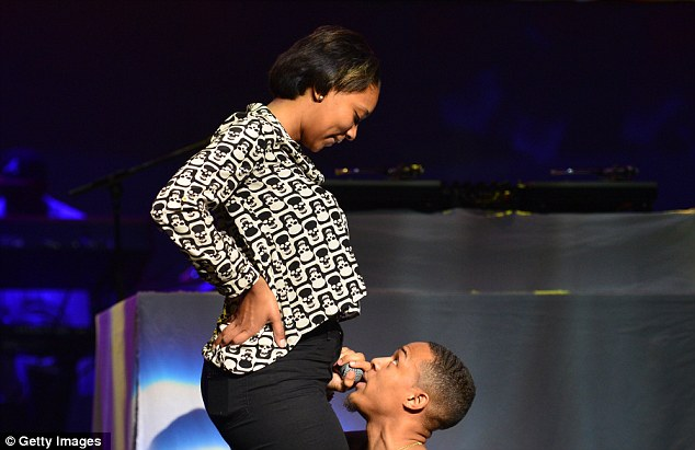 Lucky lady: Bow Wow brought an audience member on stage as she sang to her while kneeling down