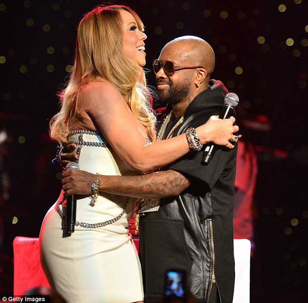 Give us a hug! Jermaine looked like the cat who got the cream as he cuddled Mariah in front of the crowd