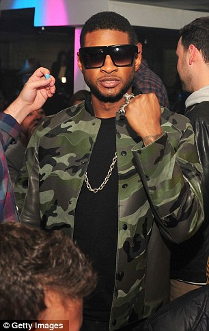 One big party: Usher and Jay-Z were seen fooling around backstage as the festivities drew to a close