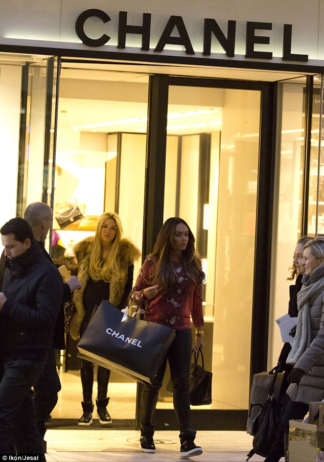Shop 'til you drop: The girls' day was far from over, with the Ecclestone sisters later spotted splashing the cash in the Chanel and Hermes stores on Bond Street