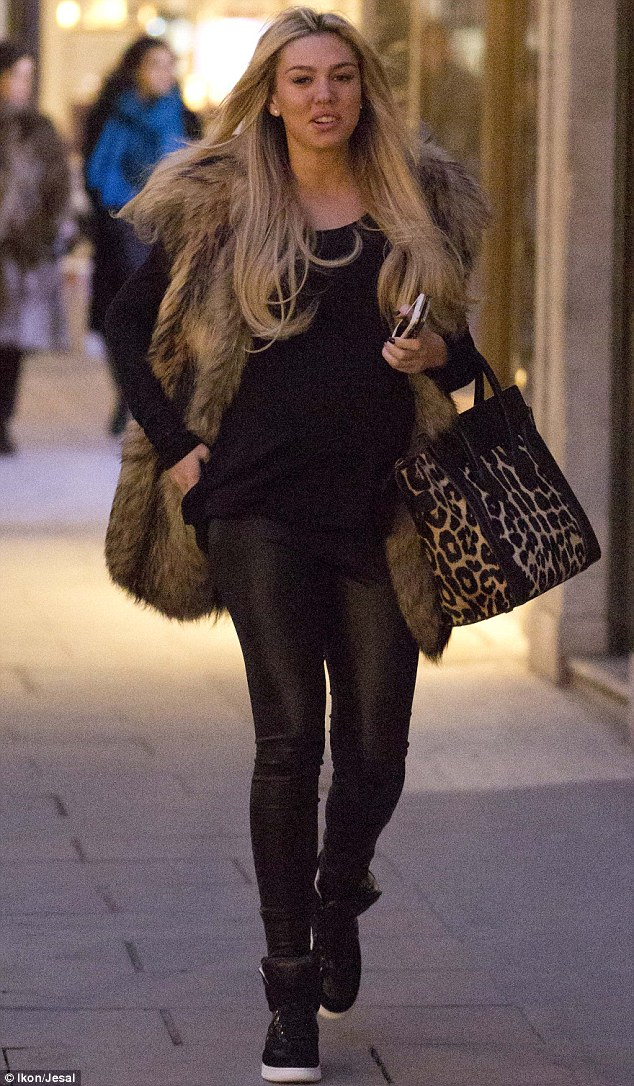Bumping along nicely: Petra showed off her adorable baby bump as she stepped out on a shopping trip alongside her sister