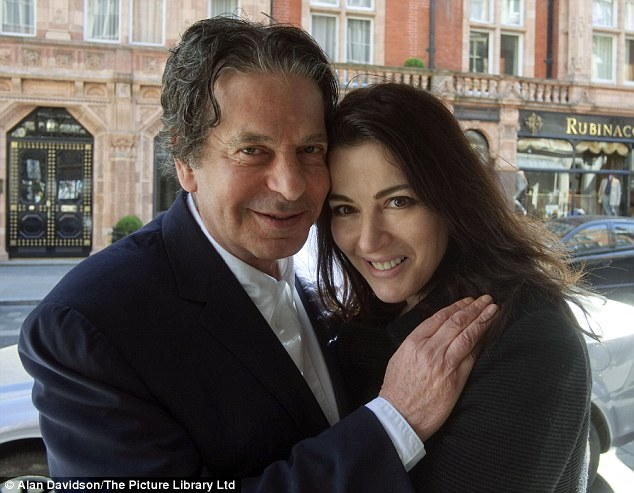 Passionate about her work: Miss Lawson, pictured with her husband, multi-millionaire Charles Saatchi, says she likes to be kept busy and enjoys producing her cooking programmes