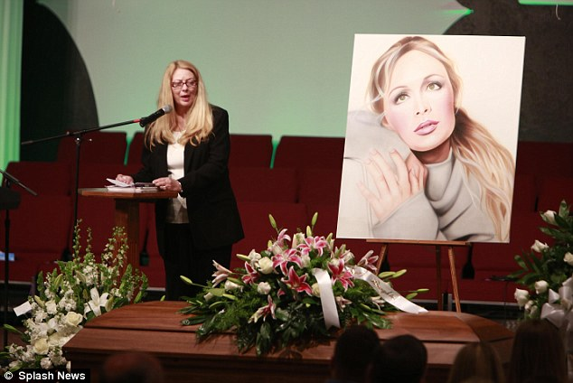 A large portrait of McCready graced the stage, and her casket was covered with white roses as her mother Gayle Inge gave an emotional eulogy