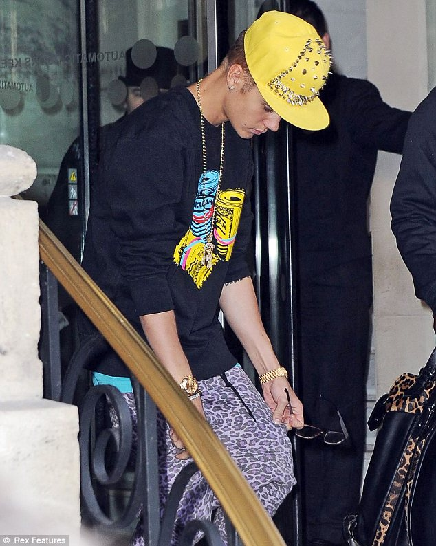 Head down: While Justin looked like he didn't want to be the centre of attention, his outfit suggested differently