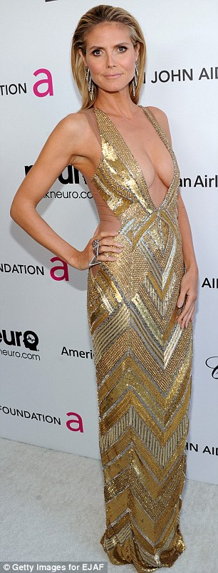 Liquid gold: Heidi just recently showed off her sublime figure when she attended the 21st Annual Elton John AIDS Foundation's Oscar Viewing Party last Sunday