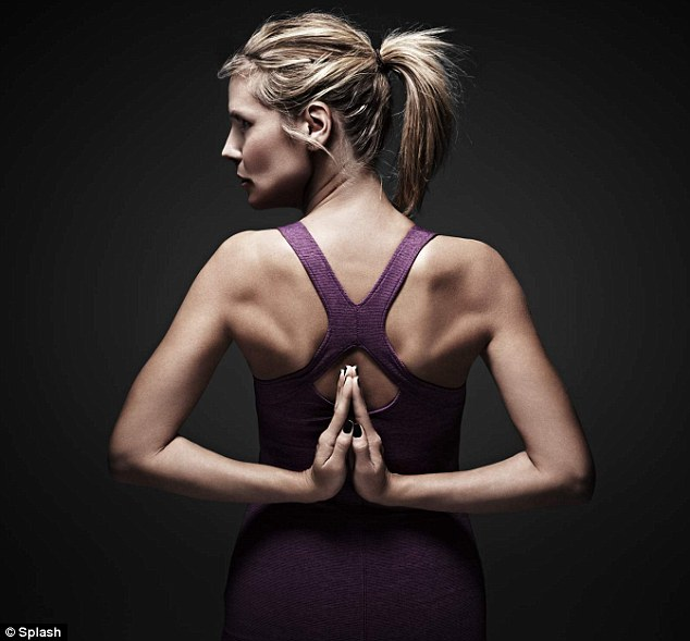 Namaste: Heidi Klum shows off her incredibly toned back in a racer back workout top in new promotional images for her very own active wear collection 'Heidi Klum for New Balance'