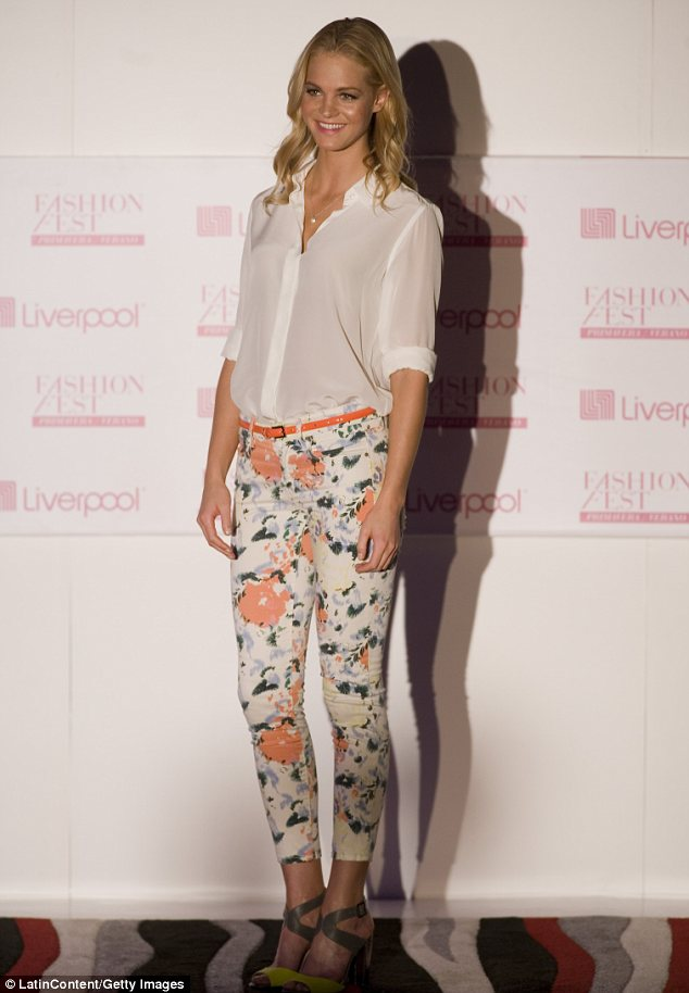 Floral delight: Erin was also seen sporting a pair of tight printed jeans and a sheer white shirt