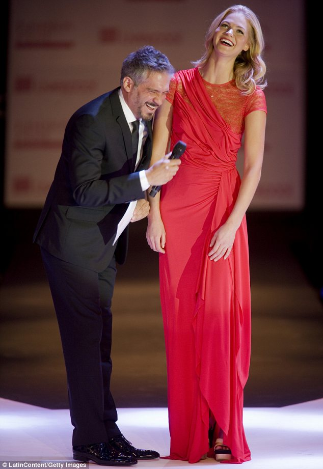 Ravishing in red: The model joined Mexican Arath de la Torre later on in the day and had changed into a lovely scarlet dress