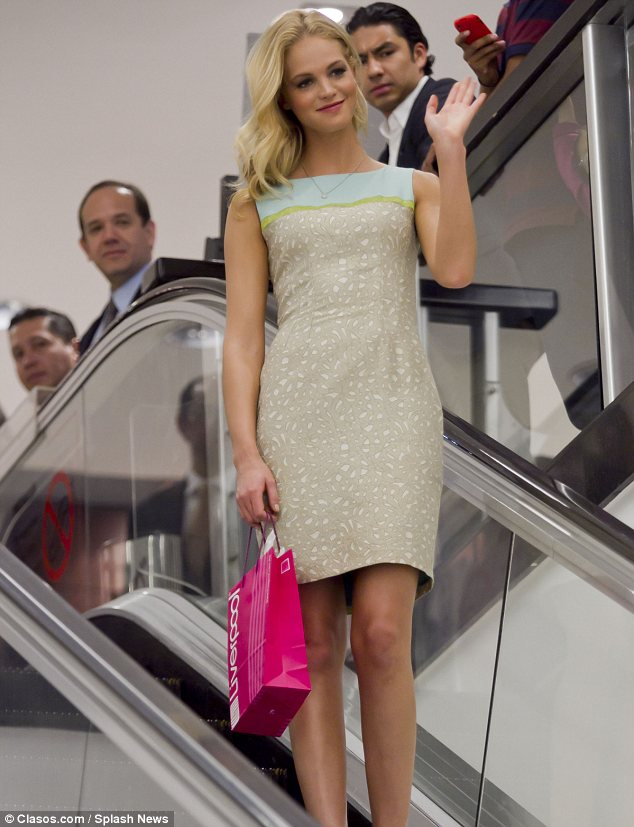 Eye-cathing: Erin Heatherton turned heads as she made her way down an escalator during the Liverpool Fashion Fest in Mexico City