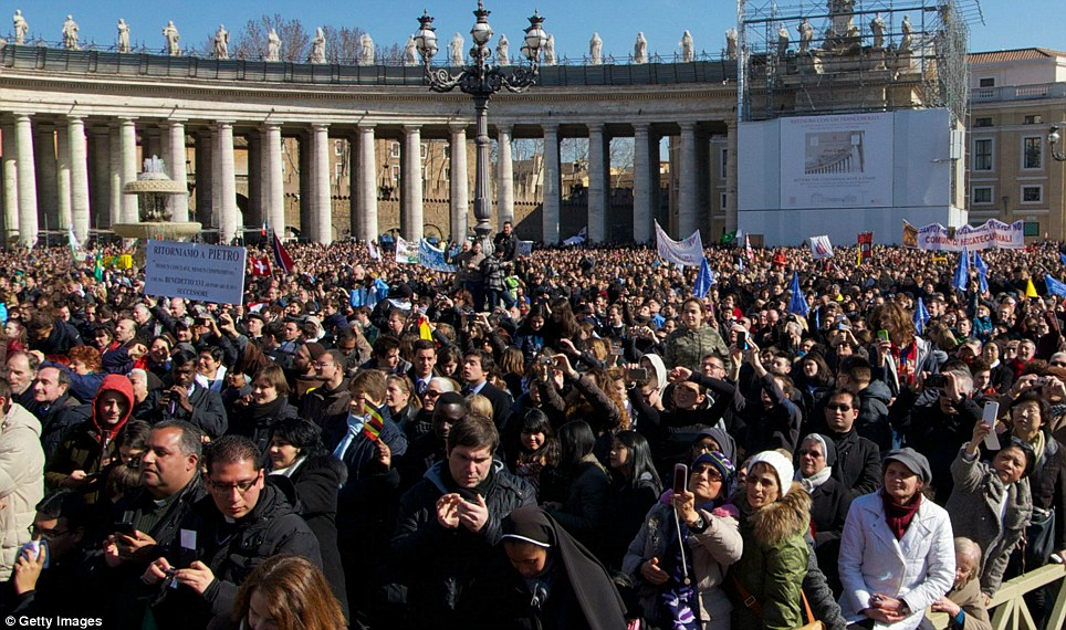 Look behind you: This is the view of the faithful gathered at St Peter's Square in Vatican City when the panoramic photo is moved around 180 degrees