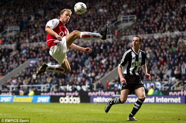 'Honoured': The statue will depict this touch by Bergkamp in 2003
