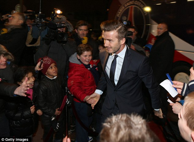 Mobbed by fans: The footballer seems used to the fact that he is surrounded by hordes of adoring fans