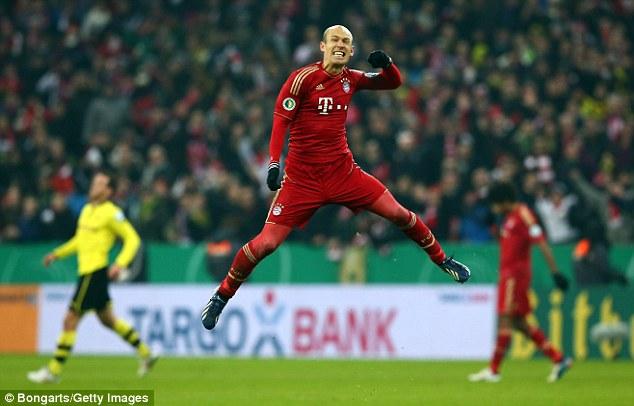 Jumping for joy: Robben celebrates his winning strike