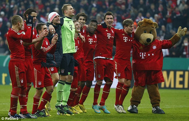 Bear necessities: Bayern fans celebrate a famous victory over their old foes
