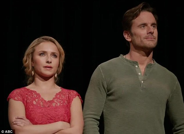Co-stars: Hayden stands onstage with her co-star Charles Esten at the beginning of the clip