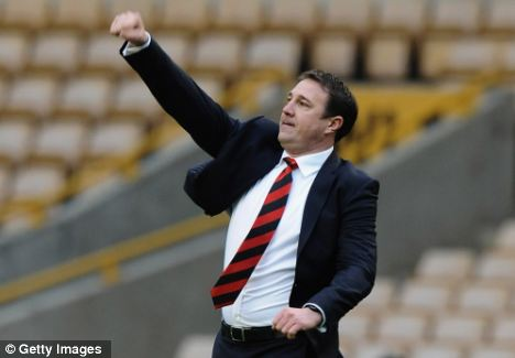 Punching the air: Malky Mackay's Cardiff are eight points clear but Holloway believes they can still be caught