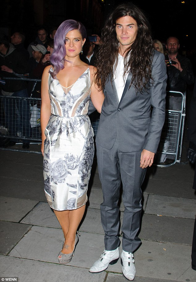 Happy couple: Matthew Mosshart played nurse, getting Kelly Osbourne a leg scratcher to use with her casted leg