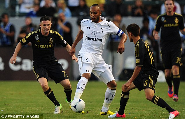 Leader: The Frenchman (centre) captained Spurs when they played Robbie Keane (left) and LA Galaxy on their pre-season tour