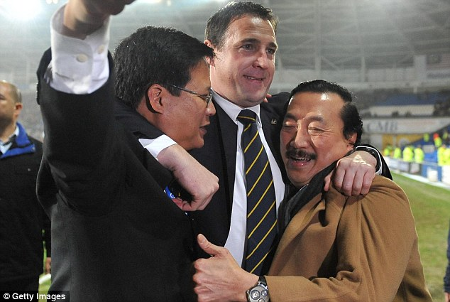 Easier times: Vincent Tan (right) celebrates with Malky Mackay (centre) after Cardiff City reached the 2012 League Cup Final
