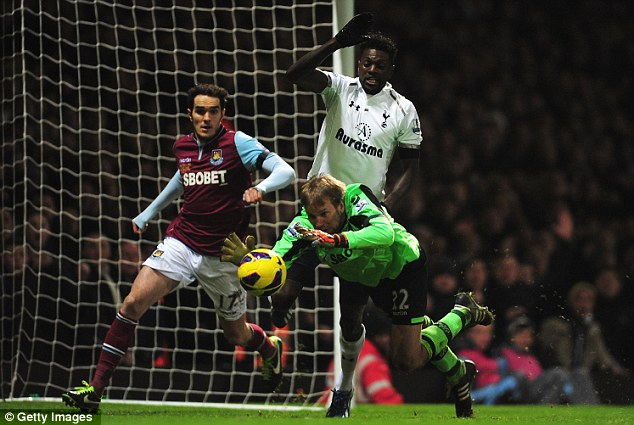 Out of sorts: Adebayor has scored only two goals this season from 16 appearances