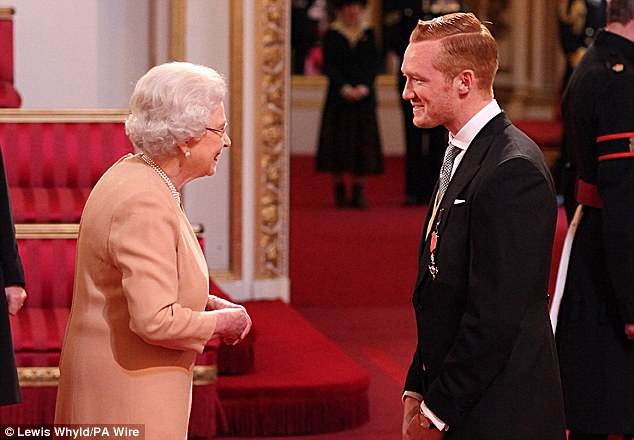 Nervous: Greg Rutherford admitted to his heart racing before meeting the Queen to collect his MBE today.