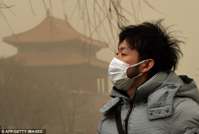 Stay indoors: Beijing residents were urged not to go outside or to protect themselves with a facemask
