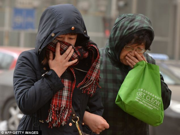 Pollution: Residents in Beijing were told to cover their faces to avoid breathing the 'hazardous' air
