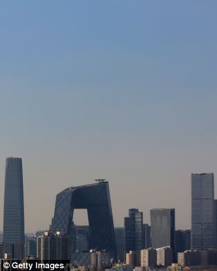 Disappeared: Visibility was so poor that some of Beijing's tallest skyscrapers could barely be seen through the haze