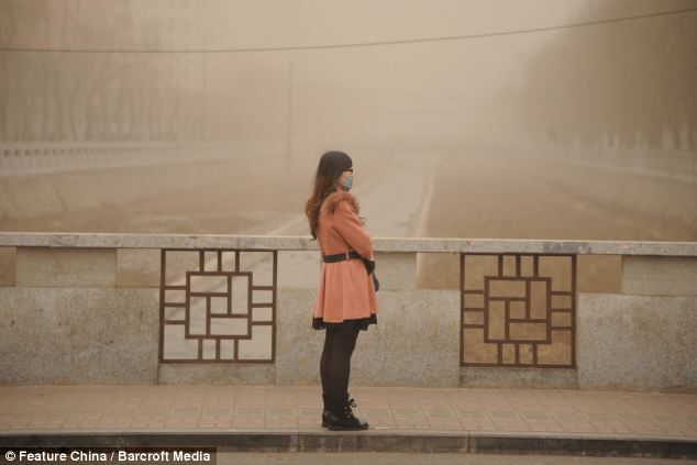 Protection: Many residents were forced to wear facemasks, suchh as this woman in Taiyuan