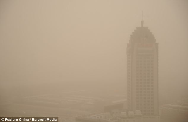 Blanketed: Visibility in the Northern city of Taiyuan was severely reduced by the sandstorm