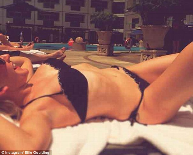 Smoking: Ellie Goulding shared a picture of herself sunbathing while in Singapore