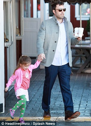 Bonding time: Seraphina looked thrilled to be out with her dad as she laughed and skipped alongside him