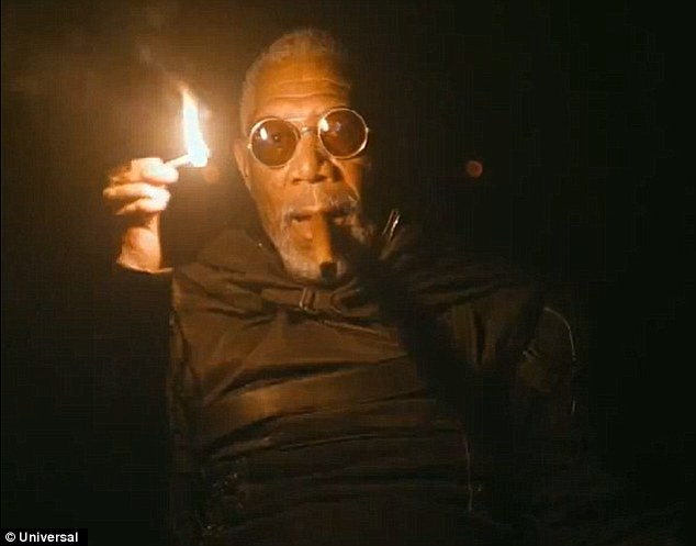 Meeting his match: Tom is given a rude awakening after his unfortunate robot encounter by Morgan Freeman, who finds it surprisingly easy to find cigars in the post apocalyptic future