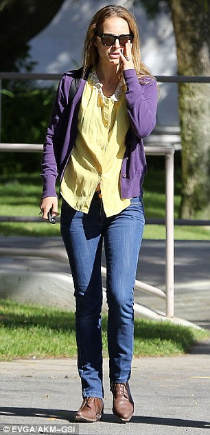 Keeping it causal: The 31-year-old movie star paired her jeans and T-shirt look with brown flats and let her hair fly