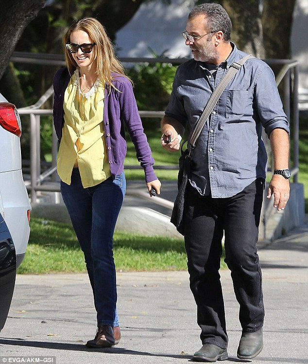 Charmed: The pair smiled as they walked along in sunny Los Angeles