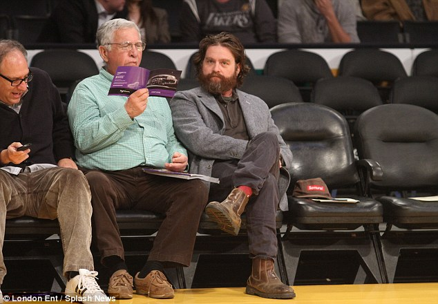 All alone? Actor Zach Galifianakis leaves his wife at home for the game, sitting with some male companions