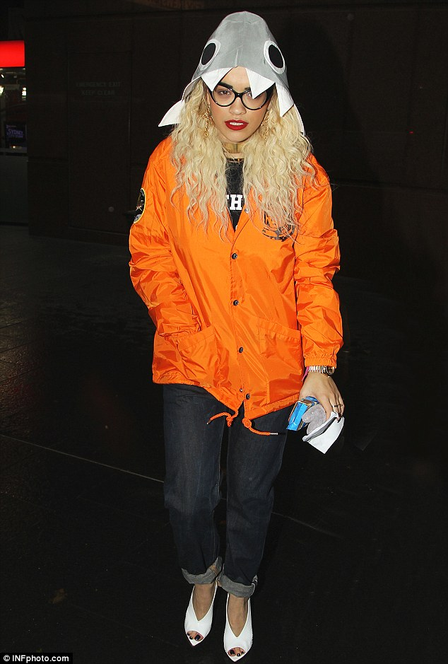 Winging it: Rita Ora was looking very much like a chicken as she left Sunrise Studios in Sydney, Australia on Friday