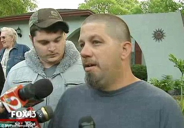 Rescue attempt: His brother heard his screams for help and rushed to his room where he saw the huge hole