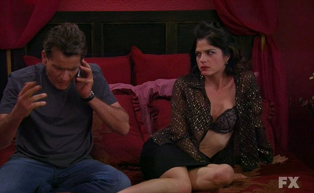 Not impressed: Selma gives him daggers as he chats on the phone, ruining their intimate moment